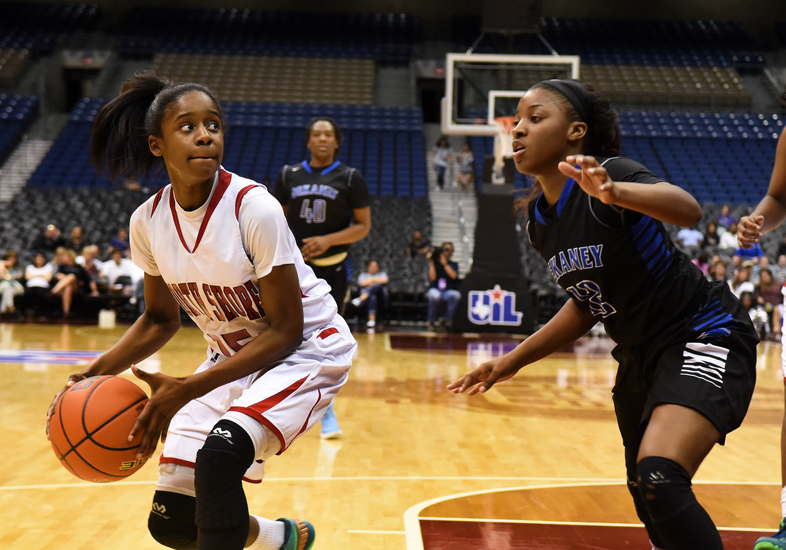 North Shore junior guard Chasity Patterson (15) works the ball against Dekaney senior guard Kene Hamilton during 2nd quarter action of their Class 6A girls basketball state semifinal versus Dekaney at the Alamodome in San Antonio on Friday, Mar. 4, 2016. (Photo by Jerry Baker/Freelance)